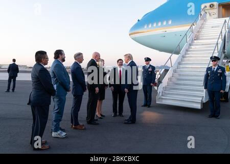 President Donald J. Trump disembarks Air Force One at Phoenix Sky Harbor International Airport in Phoenix Wednesday, Feb. 19, 2020, and is greeted by Arizona Governor Doug Ducey, right, joined by state and local officials, prior to attending a rally at the Arizona Veterans Memorial Coliseum in Phoenix. President Trump Arrives in Arizona - Stock Photo