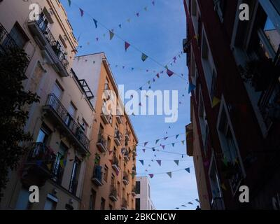Madrid, Spain. 3rd May, 2020. A street of Rastro neighborhood decorated by the neighbors with paper chains and other decoration elements during Madrid's lockdown fighting against COVID-19 pandemic. © Valentin Sama-Rojo/Alamy Live News. - Stock Photo