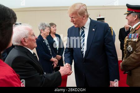 President Donald J. Trump, joined by Britain's Queen Elizabeth II,  meets with World War II veterans and their families during a D-Day National Commemorative Event Wednesday, June 5, 2019, at the Southsea Common in Portsmouth, England. President Trump Attends a D-Day National Commemorative Event Stock Photo
