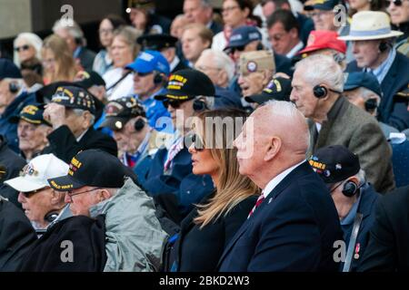 First Lady Melania Trump looks on as President Donald J. Trump delivers remarks at the 75th Commemoration of D-Day Thursday, June 6, 2019, at the Normandy American Cemetery in Normandy, France. President Trump at DDay75 - Stock Photo