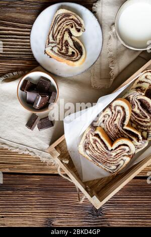 Delicious slices of traditional homemade chocolate Babka bread - Stock Photo