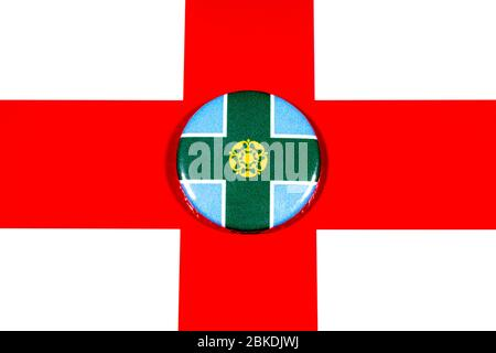 A badge portraying the flag of the English county of Derbyshire pictured over the England flag. - Stock Photo