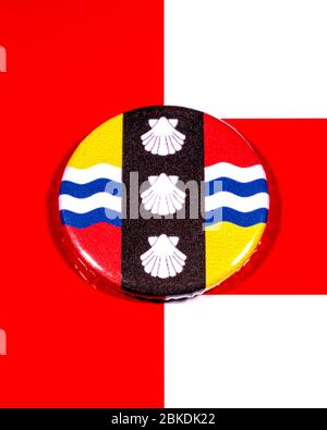 A badge portraying the flag of the English county of Bedfordshire pictured over the England flag. - Stock Photo