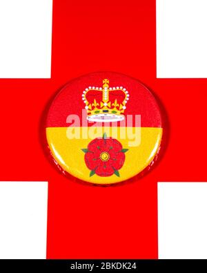 A badge portraying the flag of the English county of Hampshire pictured over the England flag. - Stock Photo