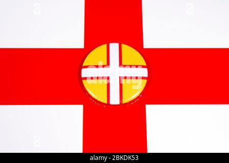 A badge portraying the flag of the English county of Dorset, pictured over the England flag. - Stock Photo