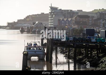 Boats along Newhaven West Quay, East Sussex. UK - Stock Photo