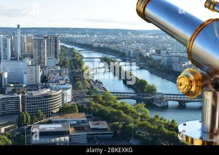 Parisian cityscape from the Tour Eiffel or Eiffel Tower viewpoint with spyglass. Paris, France. - Stock Photo