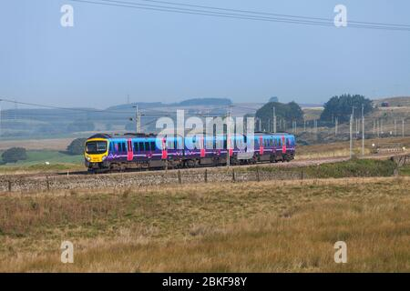 First Transpennine Express Siemens Desiro UK class 185 diesel train 185126 passing Scout Green on the west coast mainline in Cumbria - Stock Photo