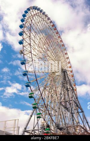 Osaka / Japan - December 25, 2017: Tempozan Ferris Wheel in Osaka, Japan, next to Osaka Aquarium Kaiyukan, one of the tallest Ferris wheels in the wor - Stock Photo