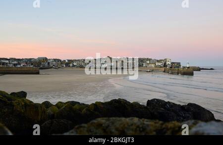 St Ives Harbour at sunset in winter. Cornwall, UK.