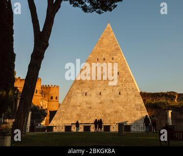 The Pyramid of Cestius forms part of the Aurelian Wall, seen from the  Non-Catholic Cemetery where Keats is buried in Rome, Italy - Stock Photo