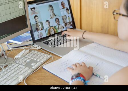 Girl attending online school classes from home - Stock Photo