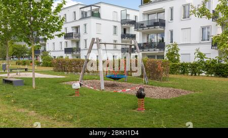 Munich, Bavaria / Germany - May 3, 2020: Closed playground with red - white barrier tape. Playgrounds re-opened on May 6 (were closed due to Covid-19) - Stock Photo