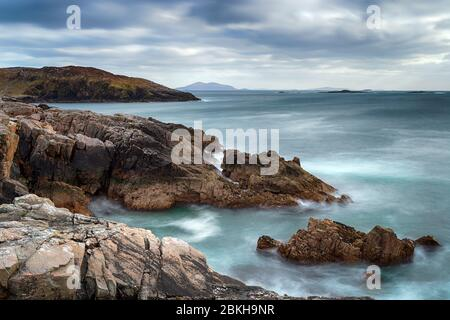A long exposure of moody skies and rugged cliffs at Hushinish on the Isle of Harris in the Western Isles of Scotland