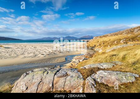 Beautiful blue skies and sunshine at Traigh Rosamol beach at Luskentyre on the Ilse of Harris in Scotland