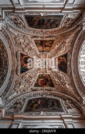 Feb 4, 2020 - Salzburg, Austria: Upward view marble ceiling with baroque ornamentation with paintings in the aisle inside Salzburg Cathedral - Stock Photo