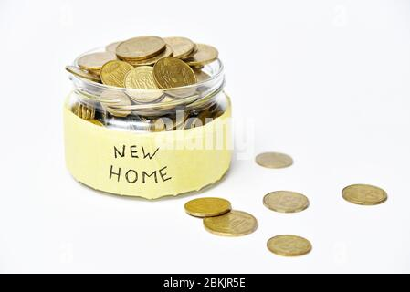 Glass jar with coins, bank with money for a new house - Stock Photo