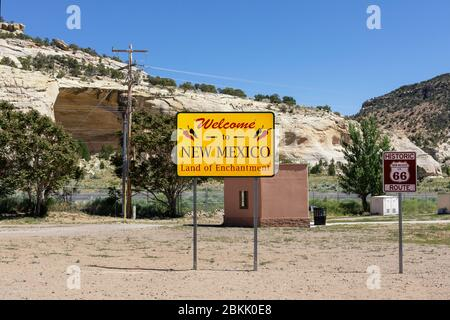 Welcome to New Mexico sign along the highway at the state border. - Stock Photo
