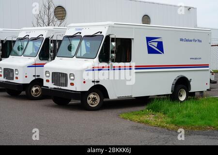 WEST WINDSOR, NJ -3 MAY 2020- View of mail delivery trucks from the United States Postal Service (USPS) at the Carnegie Center post office in New Jers