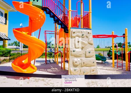 A playground is roped off and closed due to the coronavirus at Gulfport Premium Outlets, May 1, 2020, in Gulfport, Mississippi. - Stock Photo