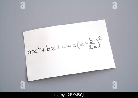 algebra equation on piece of paper - Stock Photo