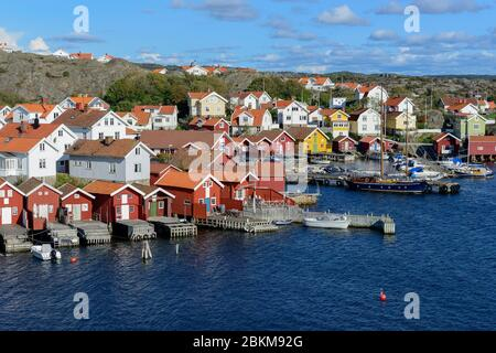 Falu red fishermen's houses in harbour, Orust, Hälleviksstrand, Bohuslän, Sweden - Stock Photo