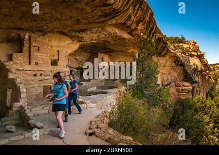 Tourists seen in the Balcony House site. Mesa Verde National Park, Colorado, USA.