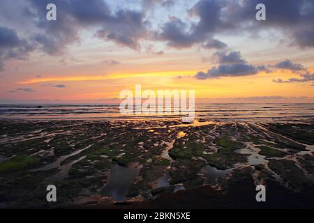Sunset over rock pools, close to Sirena Ranger Station, Corcovado National Park, Osa Peninsula, Costa Rica. - Stock Photo