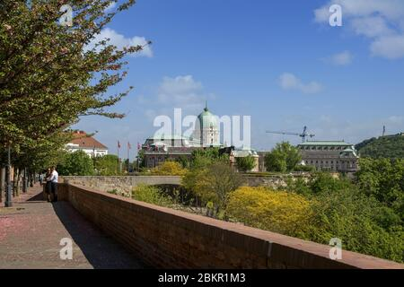 The popular Toth Arpad Promenade in Buda castle district in spring time. Buda Castle Royal Palace at background.Budapest,Hungary,Europe. - Stock Photo