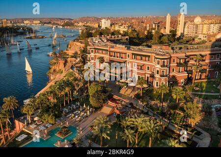 Egypt, Upper Egypt, Nile valley, Aswan, the Sofitel Legend Old Cataract Hotel in front of Elephantine island - Stock Photo