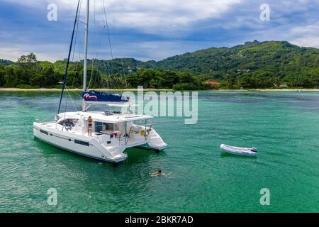 Seychelles, Mahe island, Anse Royale, sailing boat at the anchor (aerial view)