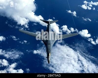 A U.S. Air Force B-1B Lancer stealth bomber, assigned to the 37th Expeditionary Bomb Squadron, flies over the South Pacific Ocean during bilateral training with the Royal Australian Air Force October 2, 2017 near Guam. - Stock Photo