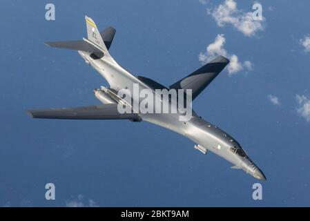A U.S. Air Force B-1B Lancer stealth bomber, assigned to the 9th Expeditionary Bomb Squadron, flies over the the South China Sea during training July 30, 2017 off the Korean Peninsula. - Stock Photo