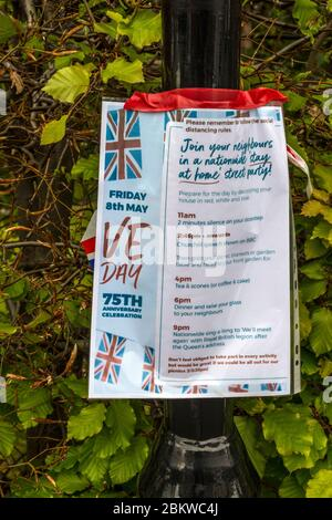 VE Day, 75th Anniversary, Street Party Poster on Lamp Post - Stock Photo