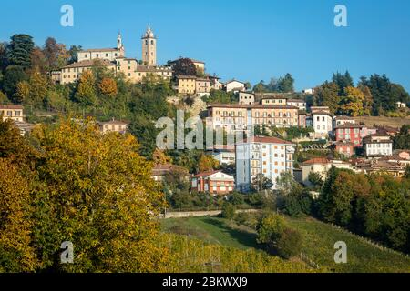 Autumn color in evening sunlight on the town of Monforte d'Alba, Piemonte, Italy