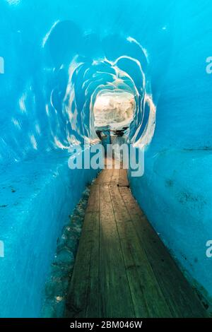 in the middle of the glacier - fascination with the old blue glacier ice, Rhone Glacier, near Furka Pass and Grimsel Pass, Canton Valais, Swiss Alps - Stock Photo