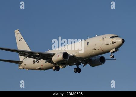 A Boeing P-8A Poseidon, multi-mission maritime aircraft, with the US Navy Patrol Squadron Eight (VP-8) flying near Naval Air Facility, Atsugi, Yamato, - Stock Photo