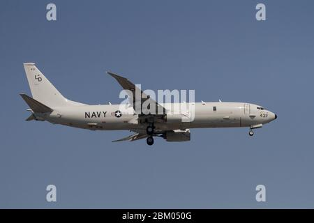 A Boeing P-8A Poseidon, multi-mission maritime aircraft, with the US Navy Patrol Squadron 10 (VP-10), nicknamed the 'Red Lancers', flying near Naval A - Stock Photo