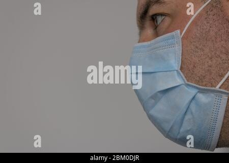 man in profile with mask