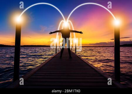 Happy, relax, successful woman thinking on bridge over sea water at sunset time with light of idea connection communication network - Stock Photo