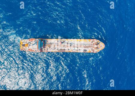 Oil chemical tanker sails blue sea. Aerial top view