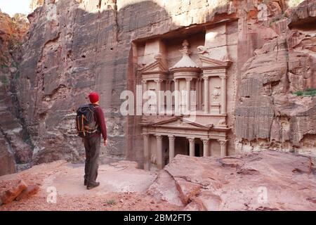 Traveler looking at the Treasury. Petra, Jordan. Toned Image. - Stock Photo