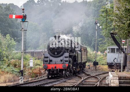 BR 2-6-0 '4MT' No. 76017 arrives at Highley on the Severn Valley Railway during their Autumn Steam Gala - Stock Photo
