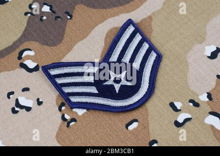 May 12, 2018. US AIR FORCE Staff Sergeant rank patch on desert camouflage uniform - Stock Photo
