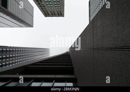 Upwards View of Multiple Skyscrapers in Downtown Chicago on a Foggy Day