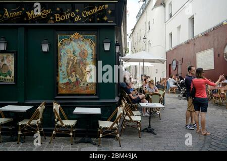 Outdoor restaurant cafe with customers in Montmartre.Paris.France - Stock Photo