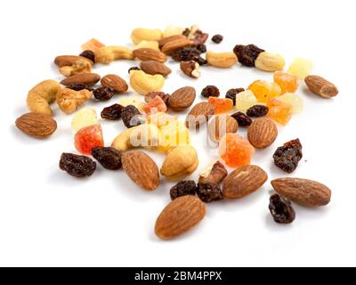 Mix of various nuts and dried fruit on white, Almonds, Raisins, Nuts, top view - Stock Photo