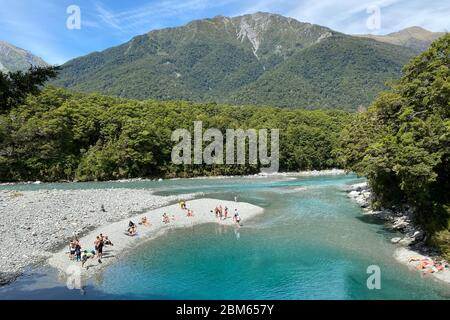 Clear, turquoise blue pools in the Makarora River in Mount Aspiring National Park, New Zealand - Stock Photo