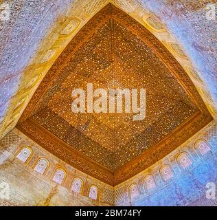 GRANADA, SPAIN - SEPTEMBER 25, 2019: Rich Mudejar decoration of Ambassadors Hall in Comares Palace (Nasrid Palace, Alhambra) with carved cupola, inlay - Stock Photo