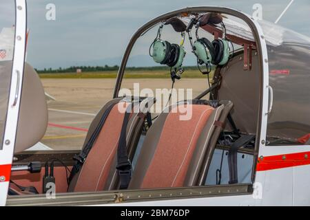 Cockpit of Croatian Air Force ZLIN 242 L basic trainer aircraft Zemunik AFB, May 17, 2008 hanging ears ear headphones headphone - Stock Photo